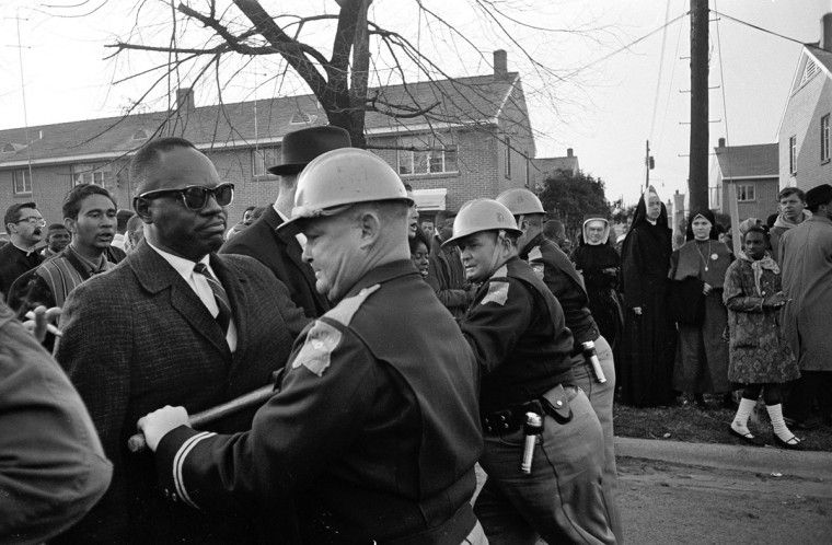 In this March 13, 1965 file photo, police block demonstrators attempting to push through their cordon in Selma, Ala. during a protest for voting rights. (AP Photo/File)
