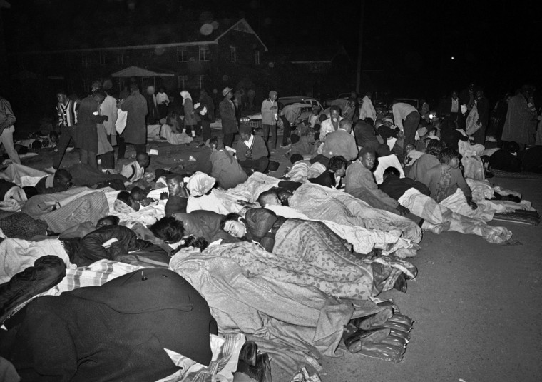 In this March 11, 1965 file photo, voters rights demonstrators sleep on the street in Selma, Ala. after several attempted marches were halted by police. (AP Photo/File)