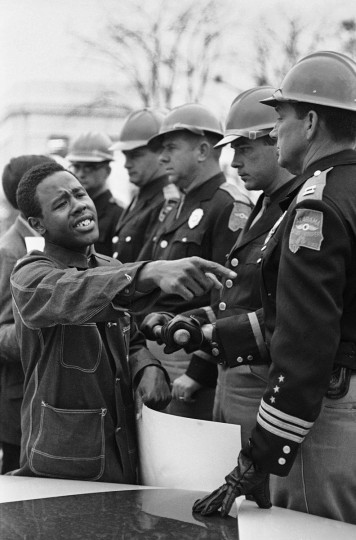 In this March 19, 1965 file photo, Willie Ricks, pleads with Alabama State Troopers to permit him and other voters rights demonstrators to picket on the sidewalk of the state capitol in Montgomery, Ala. The troopers refused. The demonstrators were arrested later by Montgomery city police. No violence occurred. (AP Photo/File)
