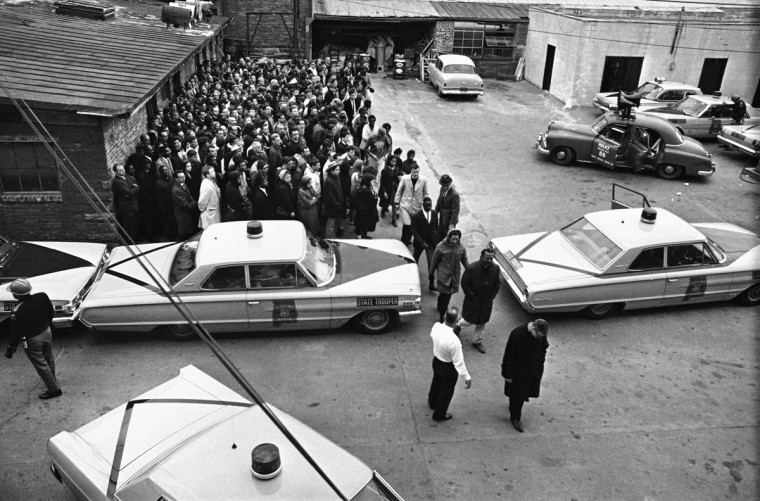 In this March 19, 1965 file photo, nearly 400 demonstrators line up in the city's courtyard in Selma, Ala. after they were arrested in an attempted march on the home of the Selma mayor. The demonstration was another in the continuing series of events protesting Alabama voting laws. (AP Photo/File)