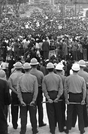 In this March 25, 1965 file photo, state troopers block the steps of the Alabama state capitol at Montgomery, Ala. from civil rights marchers at the end of their five-day march from Selma, Ala. (AP Photo/File)