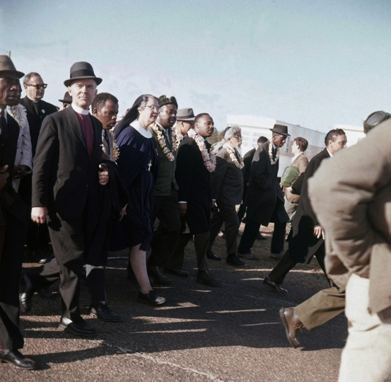 In this March 1965 file photo, Martin Luther King, center, leads a march from Selma to Montgomery, Ala. In early 1965, King's Southern Christian Leadership Conference began a series of marches as part of a push for black voting rights. (AP Photo/File)