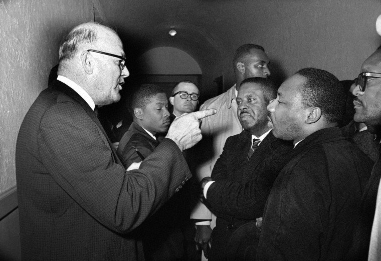"In this March 1, 1965 file photo, Registrar Carl Golson shakes a finger at Dr. Martin Luther King Jr., during meeting at the courthouse in Hayneyville, Ala. King inquired about voter registration procedures but Golson told him that if he was not a prospective voter in Lowndes county, ""It's none of your business."" King visited two nearby countries after leading a voter registration drive in Selma. (AP Photo/Harry Cabluck)"