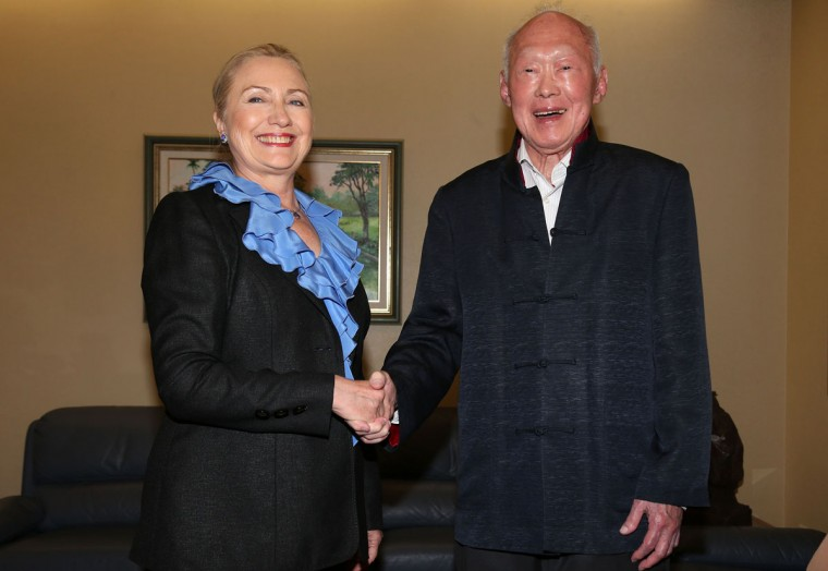 In this Nov. 16, 2012, file photo, then U.S. Secretary of State Hillary Rodham Clinton, left, poses with Singapore's then former Prime Minister Lee Kuan Yew for photographers at the Istana, or Presidential Palace, in Singapore. Lee brought prosperity to Singapore with an authoritarian system designed to outlast him, but that legacy may be ill-suited for the 21st-century challenges facing the tropical city-state. One of the last of a generation of Southeast Asian strongmen, Lee died Monday, March 23, 2015, at age 91. (AP Photo/Wong Maye-E, File)