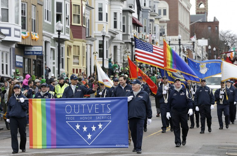 Members of OutVets, a group of gay military veterans, hold a banner and flags as they march in the St. Patrick's Day parade, Sunday, March 15, 2015, in Boston's South Boston neighborhood. Until now, gay rights groups have been barred by the South Boston Allied War Veterans Council from marching in the parade, which draws as many as a million spectators each year. (AP Photo/Steven Senne)