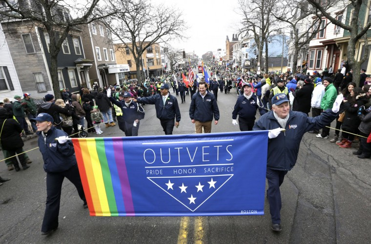 U.S. Rep. Seth Moulton, D-Mass., center without hat, marches with members of OutVets, a group of gay military veterans, during the St. Patrick's Day parade, Sunday, March 15, 2015, in Boston's South Boston neighborhood. Until now, gay rights groups have been barred by the South Boston Allied War Veterans Council from marching in the parade, which draws as many as a million spectators each year. (AP Photo/Steven Senne)