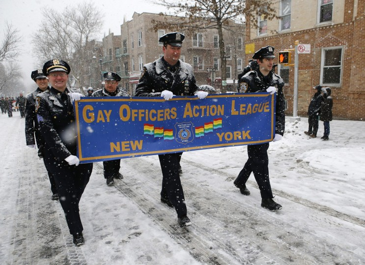 Members of the Gay Officers Action League march through a snowstorm during the all-inclusive St. Pat's For All parade in Sunnyside Queens neighborhood of New York, Sunday, March 1, 2015. The parade, which embraces diversity, is considered and alternative to New York City's official March 17, St. Patrick's Day parade. (AP Photo/Kathy Willens)