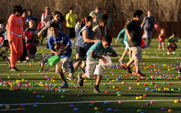 Kids take off across the field hunting Easter Eggs during the City of Abilene's Easter Egg Hunt on Saturday, March 28, 2015, at Actions Sports Zone, in Abilene, Texas. (AP Photo/The Abilene Reporter-News, Tommy Metthe)
