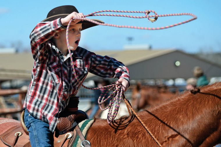 Ryder Dillard, 6, of Martinsville, Texas, practices his roping technique before entering the ring Saturday, Feb. 7, 2015, for the Pineywoods Youth Rodeo Association competition at the county Expo Center in Nacogdoches, Texas. (AP Photo/The Daily Sentinel, Andrew D. Brosig)