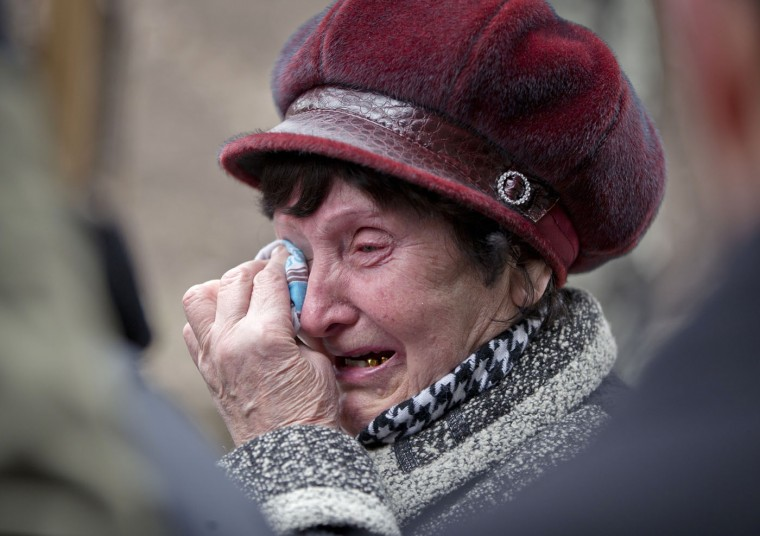 A woman cries as she waits to hear news about relatives after an explosion at the Zasyadko coal mine in Donetsk, Ukraine Wednesday March 4, 2015. An explosion took place underground at the Zasyadko coal mine in war-torn eastern Ukraine on Wednesday, an area controlled by pro-Russian rebels. (AP Photo/Vadim Ghirda)