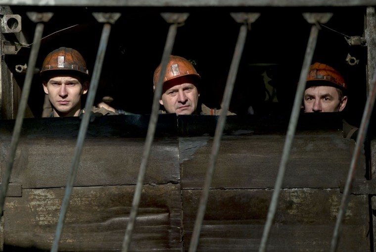 Ukrainian coal miners start their descent underground at the Zasyadko mine in Donetsk, Ukraine, Wednesday, March 4, 2015. An explosion ripped through a coal mine before dawn Wednesday in war-torn eastern Ukraine, killing at least one miner and trapping more than 30 others underground, rebel and government officials said. (AP Photo/Vadim Ghirda)