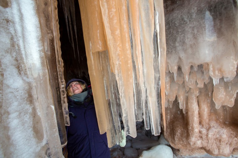 Lissa Flemming, of Bayfield, Wis., explores an ice cave at the Apostle Islands National Lakeshore on Lake Superior, Friday, Feb. 27, 2015, near Bayfield. (Zbigniew Bzdak/Chicago Tribune)