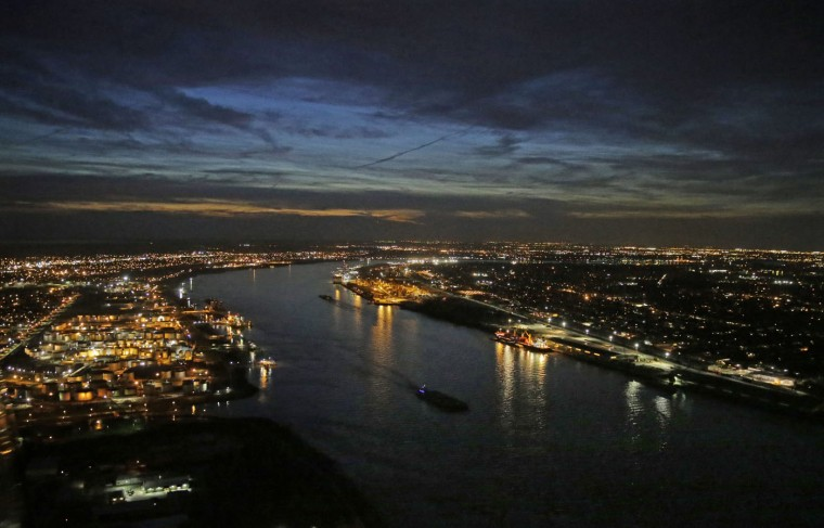 Ships travel along the Mississippi River in New Orleans on Tuesday, March 17, 2015. At about 2,300 miles long, the Mississippi is the chief river of the largest drainage system of North America. In addition to its use for heavy industry and agriculture, over 18 million people rely on the river for fresh drinking water. (AP Photo/Gerald Herbert)