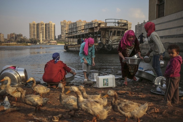 "Women wash dishes using water from the Nile River in Cairo, Egypt, on Sunday, March 15, 2015. The United Nations has designated March 22 each year as ""World Water Day,"" with the theme of 2015 as ""Water and Sustainable Development."" (AP Photo/Mosa'ab Elshamy)"