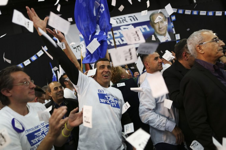 Israeli Prime Minister Benjamin Netanyahu Likud party supporters react to exit poll results at the party's election headquarters In Tel Aviv.Tuesday, March 17, 2015. Israelis are voting in early parliament elections following a campaign focused on economic issues such as the high cost of living, rather than fears of a nuclear Iran or the Israeli-Arab conflict. (AP Photo/Oded Balilty)