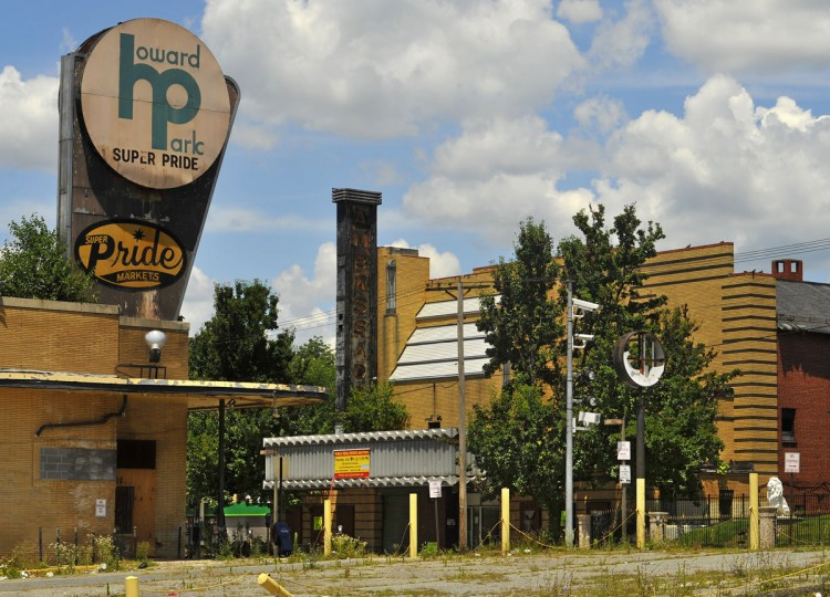 The Ambassador, an Art Deco theater built in 1935, was offered at a public auction, but the highest bid of $125,000 was too low for the seller. There were three bidders among the small crowd gathered outside the vacant theater at 4604 Liberty Heights Avenue in Howard Park. At left is an abandoned supermarket, which was torn down to make way for the ShopRite. (Amy Davis, Baltimore Sun, July 9, 2009)