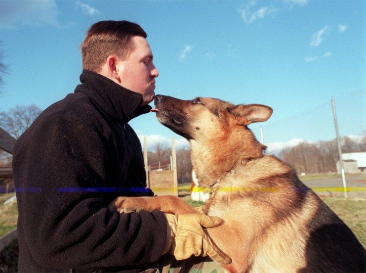 "The Maryland State Police have the oldest continuously operating K-9 unit of any state agency in the country. Here is TFC John Carhart with ""Ajax"" (Jed Kirschbaum/Baltimore Sun, 1997)"