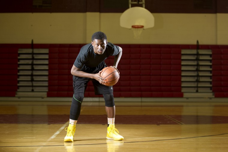 Hammond High School junior basketball player Essien Ture, 16, poses for a photo in the gym at Hammond High School in Columbia on Monday, March 9, 2015. After enduring agonizing foot pain, a grueling series of tests and surgeries that culminated with his right leg being amputated below the knee, he made a remarkable return to Hammond's basketball team. He is being recognized as part of the NFL's Block Courage Awards. (Jen Rynda/BSMG)