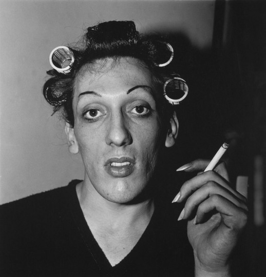 A young man in curlers at home on West 20th Street, N.Y.C, 1966. (Diane Arbus)