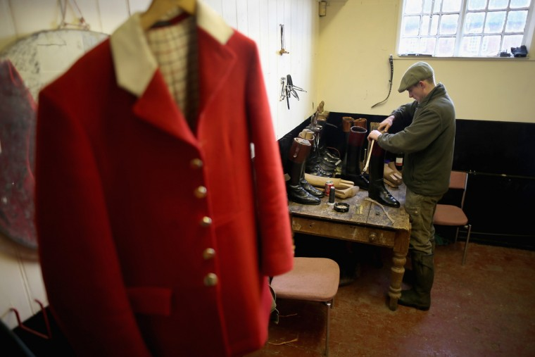 Hunstman Stuart Barton prepares his riding boots before he takes the hounds of The Atherstone Hunt out on a hunt on March 5, 2015 in Bosworth, England. The hunt is celebrating 200 years since it was formed. The historical hunt celebrated it's bicentenary with today's hunt starting from Bosworth. The hunt continues it's tradition with members paying a subscription and has 400 square miles of fox hunting ground within Warwickshire, Leicestershire and Staffordshire. (Photo by Christopher Furlong/Getty Images)