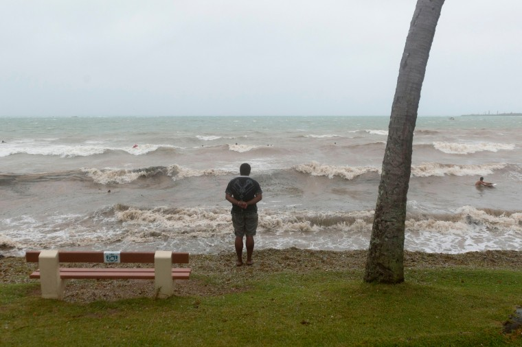 A man looks at the sea in the Anse Vata, south of Noumea, New Caledonia. Rain and wind were observed in the island but the Tropical Cyclone Pam had little effect on Noumea. The maximum category five cyclone hit Vanuatu island, 500 km east of New Caledonia, late on March 13 and early indications suggest widespread damage, including in the capital in Port Vila, with fears dozens of people could have died across the country. (Fred Payet/AFP-Getty Images)