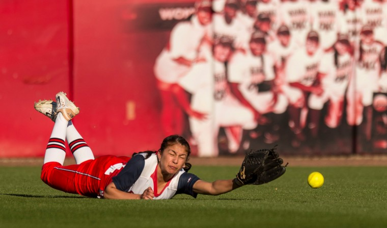 Mississippi's Melina Preciado (32) dives for a ball during an NCAA college softball game against Alabama at Rhoads Stadium in Tuscaloosa, Ala. (Vasha Hunt/Associated Press)