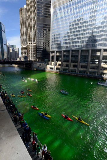 Kayakers float on the Chicago River after being dyed green ahead of the St. Patrick's Day parade in Chicago. (Paul Beaty/Associated Press)