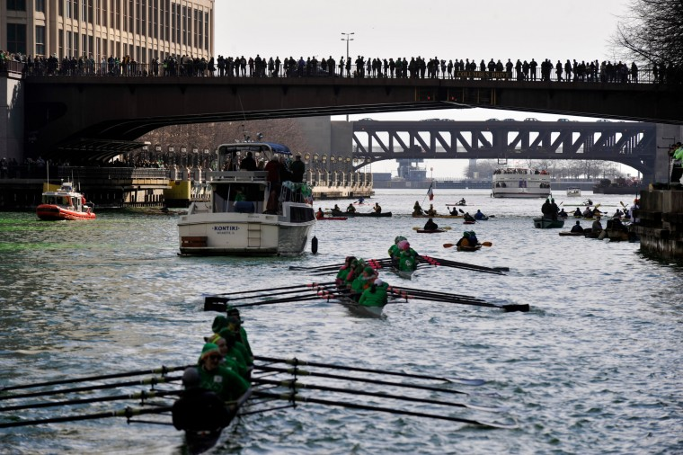 Spectators watch as the Chicago River is dyed green ahead of the St. Patrick's Day parade in Chicago. (Paul Beaty/Associated Press)