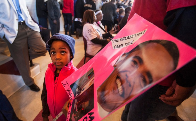 Destynee Hudson, 4, holds a sign with a photo of President Obama at a breakfast honoring the foot soldiers of the Selma March of 1965, in Selma, Ala. (Brian van der Brug/Los Angeles Times/TNS)