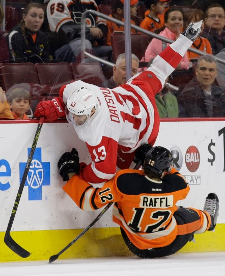 Detroit Red Wings' Pavel Datsyuk (13), of Russia, collides with Philadelphia Flyers' Michael Raffl (12), of Austria, during the first period of an NHL hockey game in Philadelphia. (Matt Slocum/Associated Press)