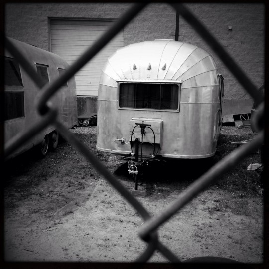 "The 1957 Airstream Caravanner, named ""Fred,"" sits at Frank's Trailer Works in Baltimore. At 22 feet, ""Fred"" is a bit larger than ""Ethel."" (Christopher T. Assaf/Baltimore Sun)"