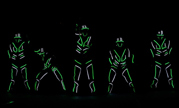 Dancers wearing neon clothes perform during an event to mark Earth Hour at a park in Manila. Millions took part around the world in the annual event organized by conservation group WWF, with hundreds of well-known sights including the Eiffel Tower in Paris and the Seattle Space Needle set to plunge into darkness. (Ted Aljibe/AFP-Getty Images)