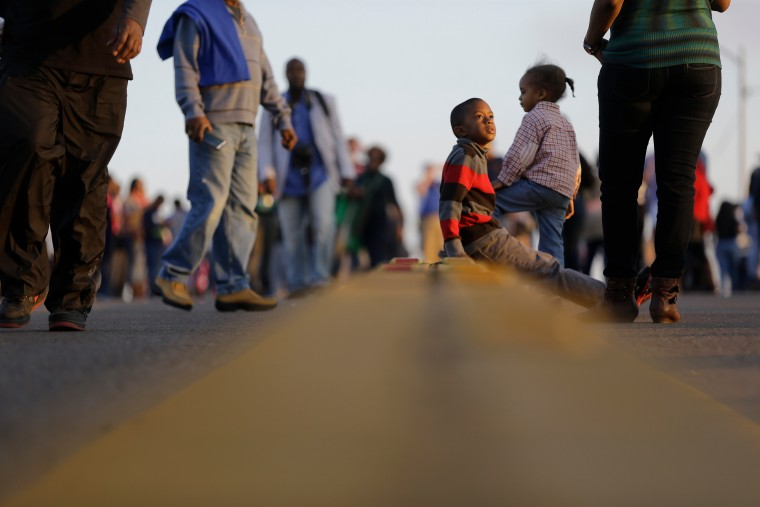 "Children and others walk and sit on the Edmund Pettus Bridge in Selma, Ala. This weekend marks the 50th anniversary of ""Bloody Sunday,"" a civil rights march in which protesters were beaten, trampled and tear-gassed by police at the Edmund Pettus Bridge in Selma, Ala. (AP Photo/Gerald Herbert) ORG XMIT: GAMS143 (Gerald Herbert/Associated Press)"