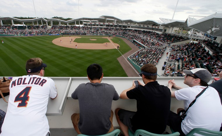 Baseball fans watch from the top of the outfield seating as the Minnesota Twins and Boston Red Sox play in the ninth inning of a spring training baseball game at jetBlue Park in Fort Myers Fla. The Red Sox won 4-2. (Tony Gutierrez/Associated Press)