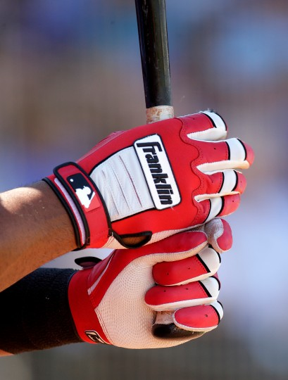 Cincinnati Reds' Yorman Rodriguez grips his bat while on deck during the third inning of a spring training baseball game against the Kansas City Royals in Surprise, Ariz. (Charlie Riedel/Associated Press)
