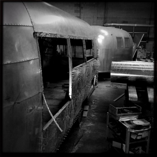 """Fred"" sits near a 1968 Airstream Caravel also being worked on at Frank's Trailer Works. (Christopher T. Assaf/Baltimore Sun)"