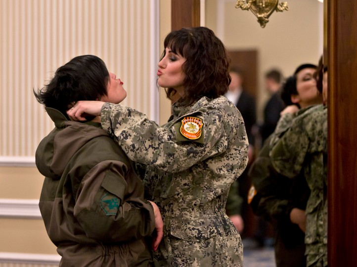 Russia-backed female rebel fighters playfully adjust their uniforms after a beauty contest involving women from the main separatist battalions in Donetsk, Ukraine. Self-proclaimed authorities in the rebel-held Donetsk held a beauty pageant for female rebel fighters on the eve of March 8, a women's day widely celebrated throughout the former Soviet Union. (Vadim Ghirda/Associated Press)