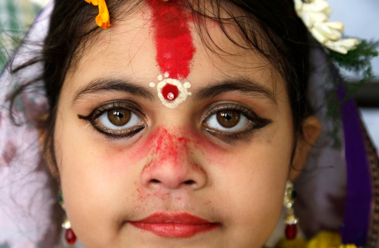 "A young Hindu girl sits for a ceremony where she and other girls are worshipped as ""Kumari,"" or living goddess, during Ram Navami festival, at a temple in Kolkata, India. Ram Navami marks the birth of Hindu God Rama. (Bikas Das/Associated Press)"