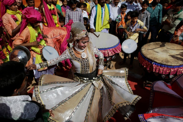A woman dances during a religious procession on Ram Navami festival in New Delhi, India, Saturday. Ram Navami marks the birth of Hindu God Rama. (Altaf Qadri/Associated Press)