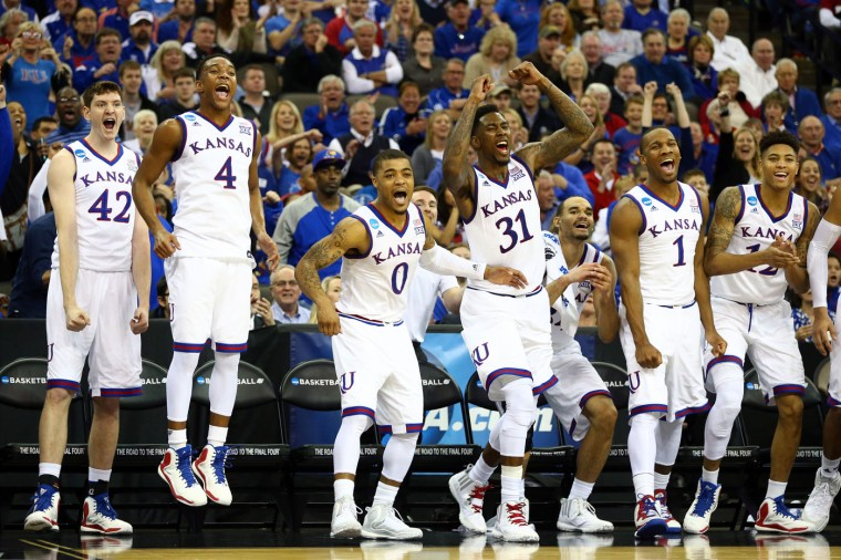 The Kansas Jayhawks bench reacts in the closing minutes against the New Mexico State Aggies during the second round of the 2015 NCAA Men's Basketball Tournament at the CenturyLink Center on March 20, 2015 in Omaha, Nebraska. (Photo by Ronald Martinez/Getty Images)
