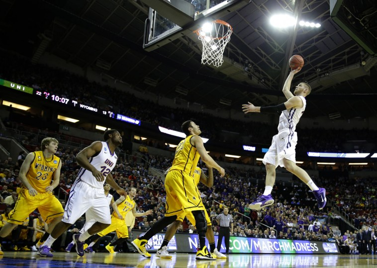 Northern Iowa forward Seth Tuttle, right, jumps to shoot against Wyoming during the first half of an NCAA tournament college basketball game in the Round of 64 in Seattle, Friday, March 20, 2015. (AP Photo/Ted S. Warren)