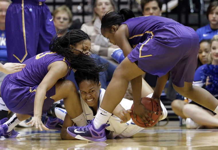 Duke's Azura Stevens, center, reaches for the ball as Albany's Margarita Rosario, left, and Imani Tate, right, defend during the second half of a women's college basketball game in the first round of the NCAA tournament in Durham, N.C., Friday, March 20, 2015. Duke won 54-52. (AP Photo/Gerry Broome)