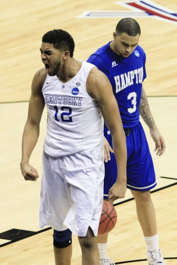 Kentucky forward Karl-Anthony Towns celebrates a basket near Hampton guard Quinton Chievous during the first half of an NCAA tournament second round college basketball game in Louisville, Ky., Thursday, March 19, 2015. (AP Photo/David Stephenson)