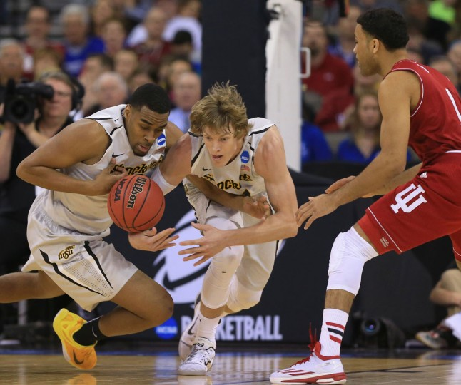 Wichita State's Darius Carter, left, Ron Baker, center, and Indiana's James Blackmon Jr. (1) compete for a loose ball during the first half of an NCAA tournament college basketball game in the Round of 64 in Omaha, Neb., Friday, March 20, 2015. (AP Photo/Nati Harnik)
