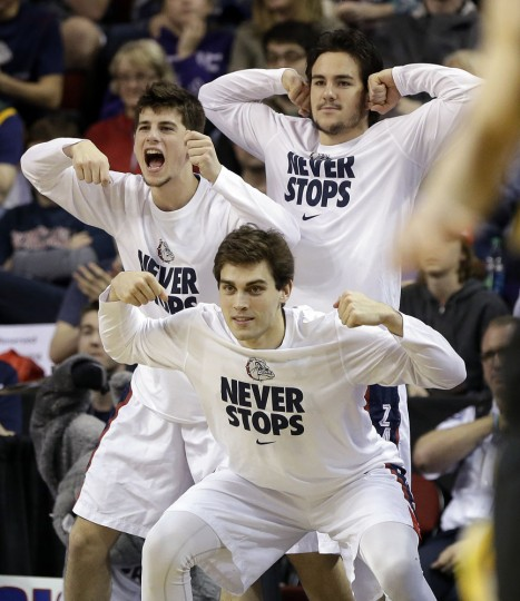 Gonzaga players react from the bench after the team scored against Iowa during the second half of an NCAA tournament college basketball game in the Round of 32 in Seattle, Sunday, March 22, 2015. (AP Photo/Elaine Thompson)
