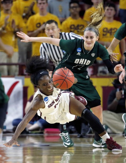 Arizona State guard Promise Amukamara, front, is tripped up by Ohio guard Mariah Byard (2) during the first half of a women's second round NCAA tournament college basketball game, Saturday, March 21, 2015, Tempe, Ariz. Arizona State won 74-55. (AP Photo/Matt York)