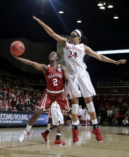 Oklahoma guard T'ona Edwards (2) scores past Stanford forward Erica McCall (24) during the first half of a women's college basketball game in the second round of the NCAA tournament Monday, March 23, 2015, in Stanford, Calif. (AP Photo/Marcio Jose Sanchez)