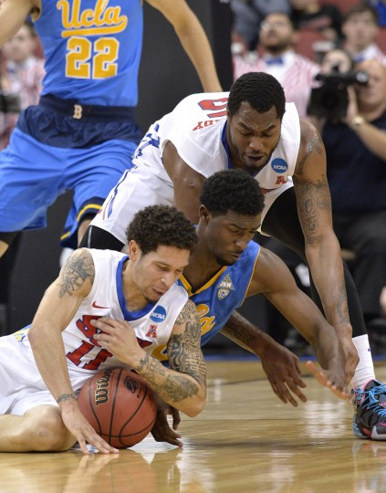 SMU's Mic Moore, bottom, and Markus Kennedy, top, battle UCLA's Isaac Hamilton for a ball during the first half of an NCAA tournament second round college basketball game in Louisville, Ky., Thursday, March 19, 2015. (AP Photo/Timothy D. Easley)