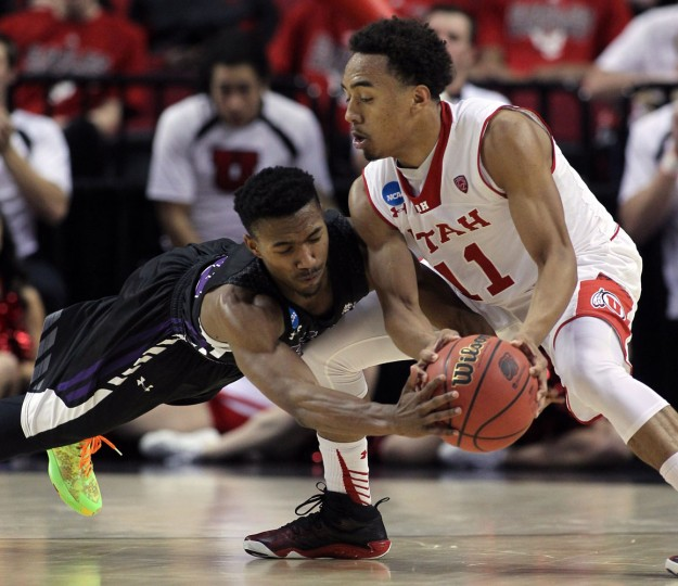 Stephen F. Austin guard Trey Pinkney, left, dives in to try and steal the ball from Utah guard Brandon Taylor during the second half of an NCAA college basketball second-round game in Portland, Ore., Thursday, March 19, 2015. (AP Photo/Craig Mitchelldyer)