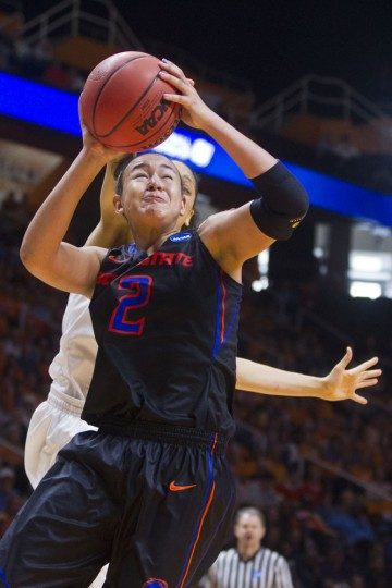 Boise State forward Shalen Shaw (2) is fouled from behind by Tennessee forward Cierra Burdick (11) as she shoots in the second half of a NCAA women's college basketball tournament game Saturday, March 21, 2015, in Knoxville, Tenn. Tennessee won 72-61. (AP Photo/Wade Payne)